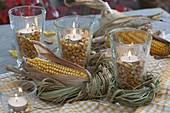 Bienchenglas glasses with corn kernels and tealights as lanterns