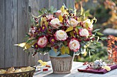 Autumn bouquet with Rose, cotoneaster with berries