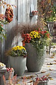 High gray tubs planted autumnally