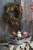 Natural Advent wreath with moss, twigs, cones and lichens