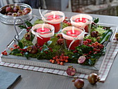 Natural Advent wreath with candle glasses, moss, Ilex branches