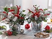 Red-silver Christmas arrangements with Ilex verticillata