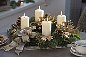 White-gold Advent wreath with white candles