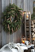 Picea omorica (spruce) wreath with cones on board wall