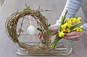 Easter window decoration with willow egg and daffodils