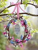 Egg-shaped wreath of Salix with Hyacinthus flowers