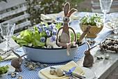 Plant enamel bowl with salad and horned violet