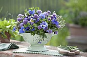 Edible arrangement in a colander, flowers of chive