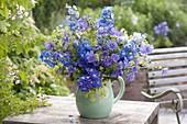 Blue-violet Delphinium (Delphinium) bouquet, Geranium