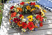 Wreath of edible flowers and herbs, marigolds (calendula)