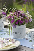 Summer table decoration with meadow flowers
