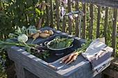 Freshly harvested vegetables immediately outside on the outdoor vanity