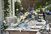 Blue and white table decoration with lilies and lilies