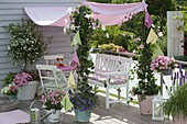 Pink-white balcony with awning