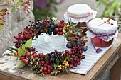 Wreath with wild fruits, sorbus, hippophae