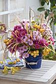 Autumn bouquet from Aster, Malus 'Golden Hornet'