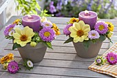 Candles in small clay pots, dahlia, callistephus