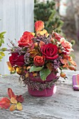 Fiery autumn bouquet with pink (rose, rosehips), Calluna