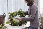 Tie ivy wreath to door