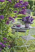 Bouquet of syringa (lilac), allium