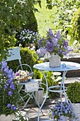 Small terrace with blue table and chair, Syringa bouquet