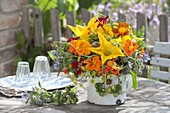 Vegetable and herb bouquet in old enamel pot