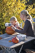 Pumpkins carve with children