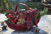 Red woodchip basket with Ilex Christmas decoration material