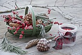 Green basket with cones, Ilex and Pinus