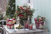 Winter table decoration with Ilex bouquet