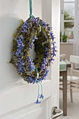 Fragrant spring wreath of moss, lichen covered branches and flowers