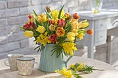 Fragrant blooming Tulipa and Acacia bouquet
