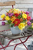 Colorful tulipa (tulip) bouquet in hand-made pot