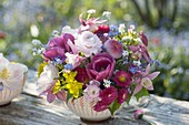 Small bouquet with bellis, ranunculus