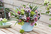 Small spring Viburnum and Bellis bouquet in Blue Pitcher