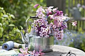 Rose-pink bouquet in silver kettle, Bergenia