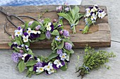 Tying a small wreath of herbs and edible flowers