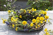 Tendrils wreath decorated with Taraxacum, Ajuga