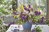 Bouquet of syringa, aquilegia, ranunculus