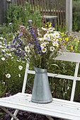 Flower meadow bouquet of Leucanthemum vulgare in zinc can