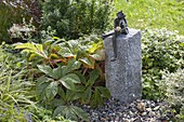 Build up water game with frog on granite pillar