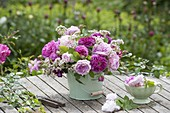 Fragrance bouquet of rose and Valeriana in a tin bucket