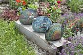 Ceramic peacocks on wooden beams at the foot
