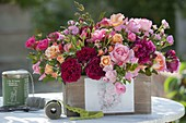 Mixed pink (rose) arrangement in wooden box with rose motive