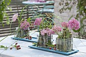 Modern table decoration with giant knotweed as plug-aid-immature blackberries