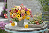 Colorful late summer bouquet on the terrace table