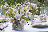 Table decoration with autumn anemones and fennel