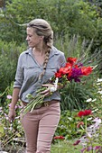 Woman with fresh cut flowers for bouquet