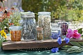 Jars with dried flowers and leaves for tea