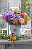 Fresh cut flowers for bouquet placed in bucket